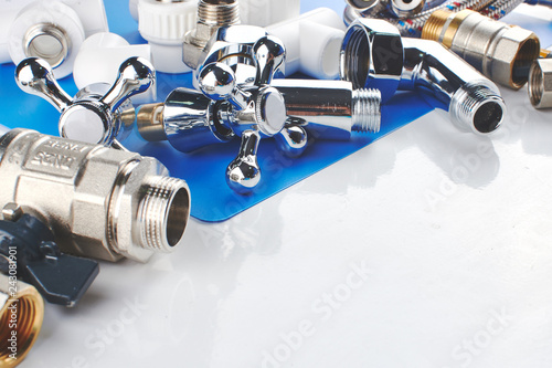 Cuadros en Lienzo Plumbing parts, accessories and tools on a blue white background.
