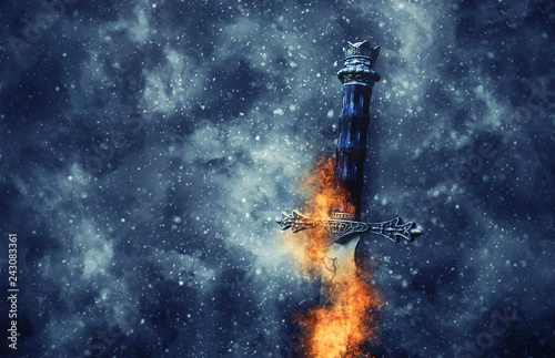 mysterious and magical photo of silver sword with fire flames over gothic snowy black background Fototapet