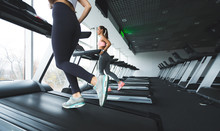 Women Running Up On Treadmill In The Gym