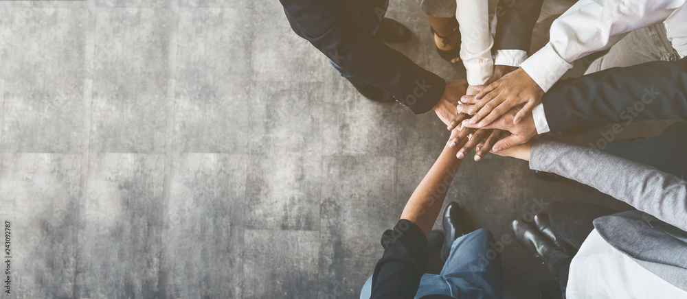 Fototapety, obrazy: Business people putting their hands together, top view