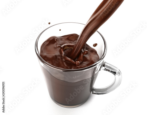 Liquid chocolate pouring in a glass mug with little splash.