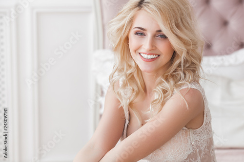 Fotografiet  Close up portrait of young beautiful woman indoors