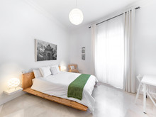 Clean Bright Bedroom With King...
