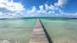 Jetty on tropical beach in vacation resort Bahamas
