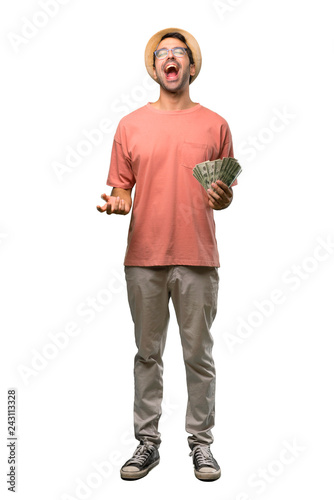 Fotografía  Man holding many bills shouting to the front with mouth wide open on isolated wh