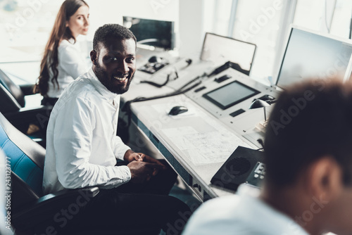 Young professional man working on dispatch board - Buy this stock