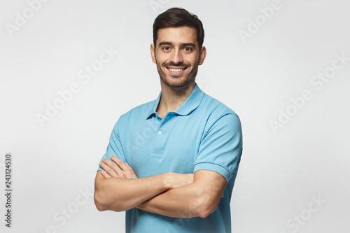 Portrait of young european caucasian man isolated on gray background, standing i Tapéta, Fotótapéta