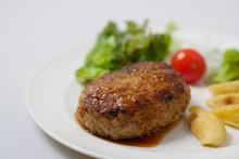 Hamburger Steak And Vegetables On White Background