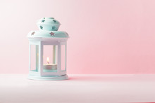 White Metallic Lantern With Burning Candle Over Pink Background, Copy Space