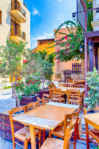 Papiers peints Europe Méditérranéenne Sunny Open Air Cafe in Chania City on Crete. With Flowers and Olive Trees All Round in Crete, Greece.