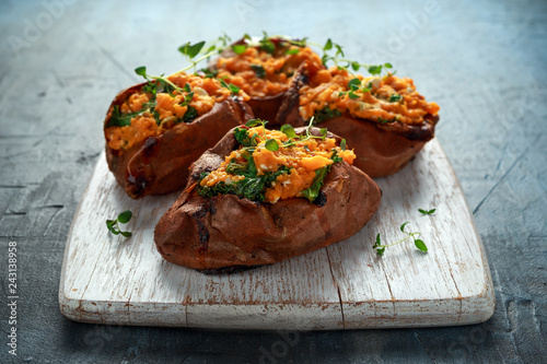 Obraz Roast sweet potato stuffed with feta cheese and kale. healthy food - fototapety do salonu