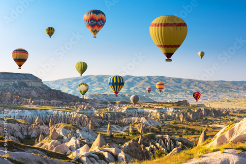 Hot air balloons flying in sunset sky Cappadocia, Turkey