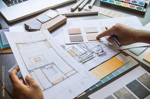 Fotografija  Architect designer Interior creative working hand drawing sketch plan blue print