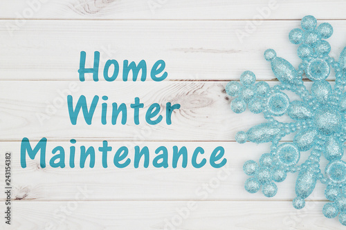 Fototapety, obrazy: Home winter maintenance message with teal snowflake
