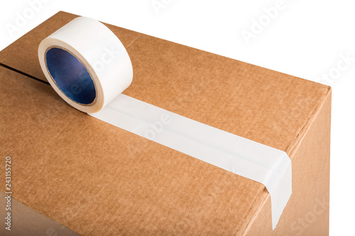 Valokuva  Closeup of cardboard box with white adhesive tape isolated on white background