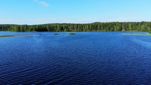 Fly Over Lake Blue Water And R...
