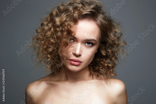 Fotografie, Obraz  Beautiful freckles woman. amazing curly girl