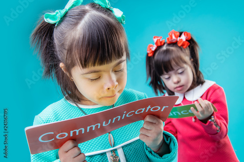 Fotografie, Obraz  Dark-haired interested girls holding posters with important messages