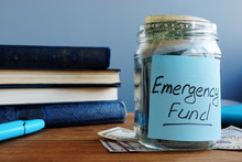 Emergency Fund Written On A Jar With Money.