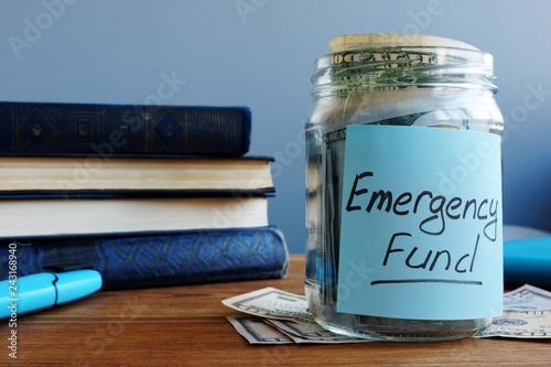 Fototapeta Emergency fund written on a jar with money. obraz