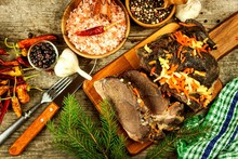 Sliced Roast Meat From Wild Boar. Pork Baked In The Oven. Wild Game Hunting.