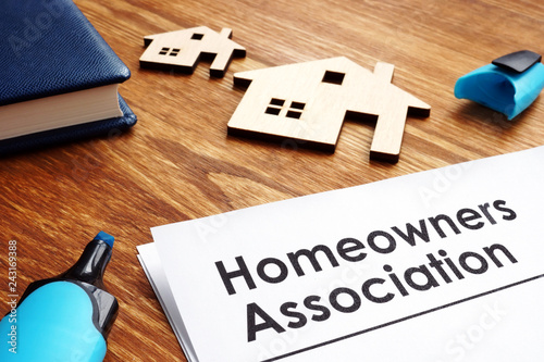 Documents about Homeowners Association HOA on a desk. Wallpaper Mural