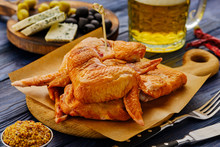 Smoked Chicken Wings With Beer On A Wooden Table