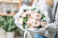 Beautiful Fresh Cut Bouquet Of Mixed Flowers In Woman Hand. The Work Of The Florist At A Flower Shop