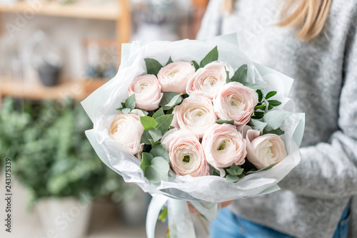 Fotografie, Obraz  beautiful fresh cut bouquet of mixed flowers in woman hand