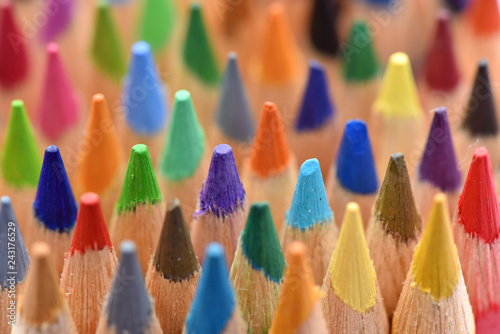 Photo  Color pencils, macro. Bright background. Stationery for drawing.
