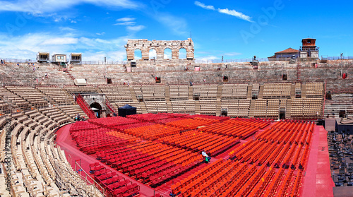 Staande foto Stadion Inside of Arena of Verona in Italy / Red seats under blue sky in the theater