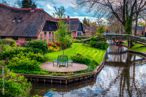 Dutch village with colorful ornamental garden and water canal, Giethoorn Canvas