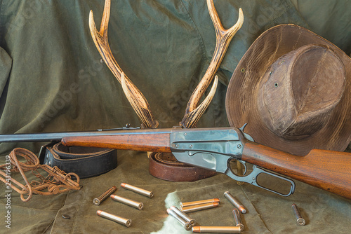 Hunting equipment in western style: carbine, hat,bullets trap and deer antlers