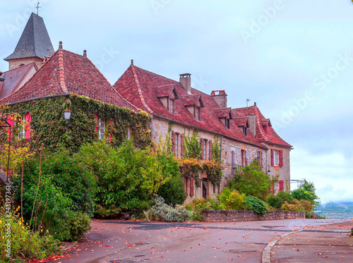 Obraz na płótnie Medieval village of Aquitaine with its stone houses in the south of France on a cloudy day