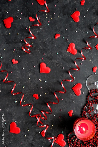 Valentine's Day background with glasses, candle and red heart. Top view with copy space. Valentine's Day concept.