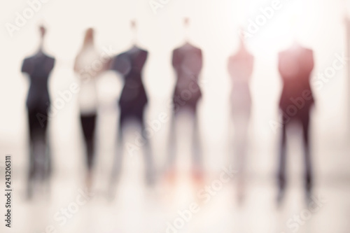 Obraz business background.a group of business people standing in the o - fototapety do salonu