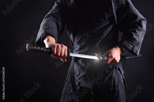 Fototapeta Ninja samurai bared his sword