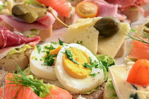 Foto op Canvas Buffet, Bar various canapes with egg, cheese, ham and salmon at the cold buffet, close-up view