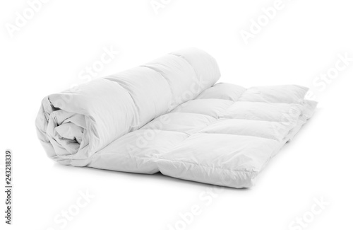 Obraz Rolled soft blanket on white background. Textile for bedroom interior - fototapety do salonu