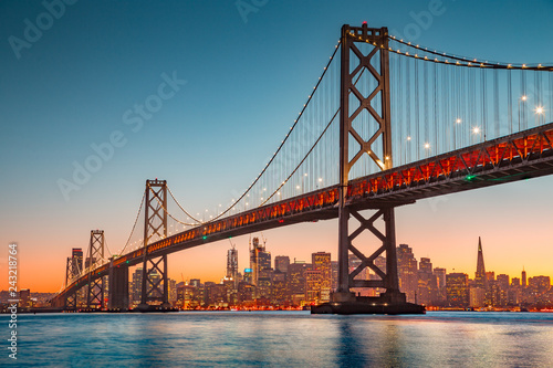 Spoed Fotobehang Bruggen San Francisco skyline with Oakland Bay Bridge at sunset, California, USA