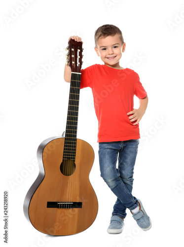 Little boy with acoustic guitar on white background