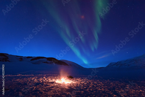 Foto auf Gartenposter Nordlicht The polar arctic Northern lights aurora borealis sky star in Norway Svalbard in Longyearbyen the moon mountains with fire flame
