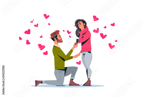 Fotomural man kneeling holding engagement ring proposing woman marry him happy valentines