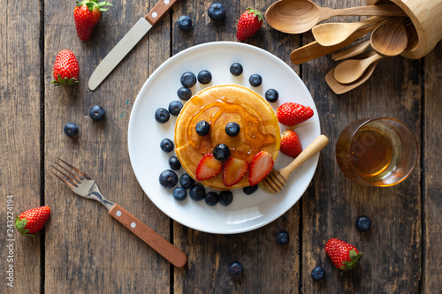Fotografie, Obraz  Delicious pancakes with Strawberry and blueberry on wooden table