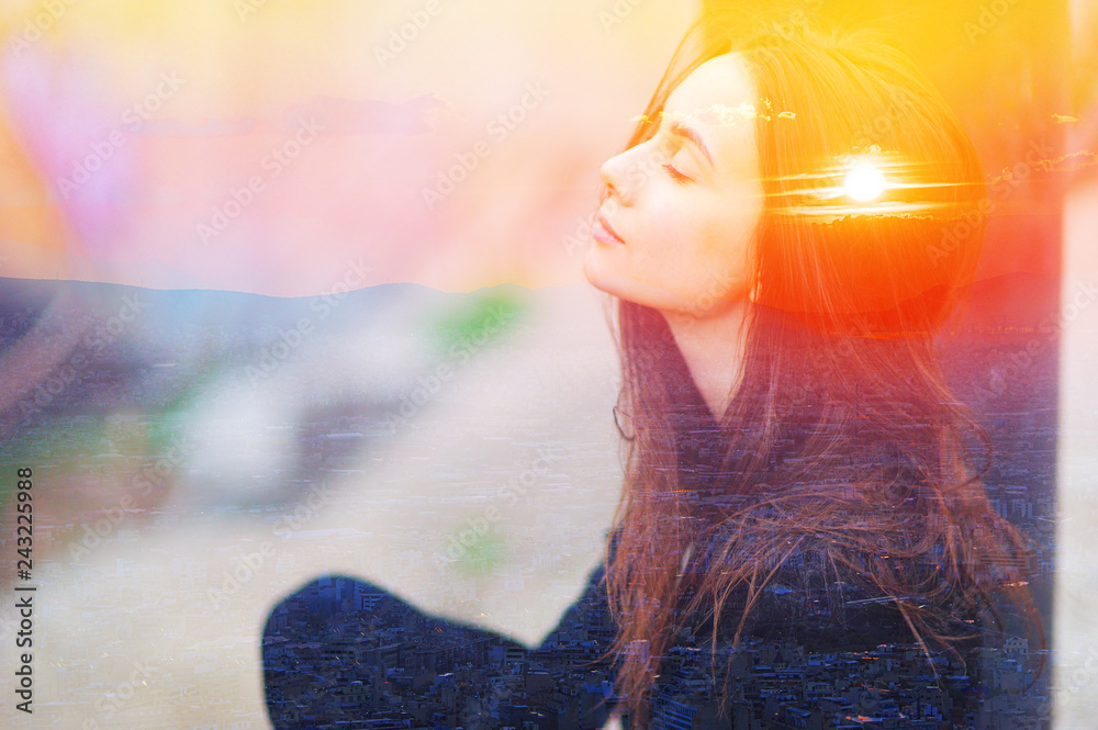 Fototapety, obrazy: Double multiply exposure portrait of a dreamy cute woman meditating outdoors with eyes closed, combined with photograph of nature, sunrise or sunset. closeup. Psychology power of mind concept.