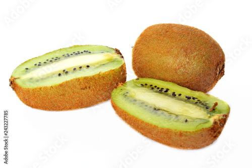 Fotografía  Two halves and whole yellow tropical exotic kiwi fruit on white background