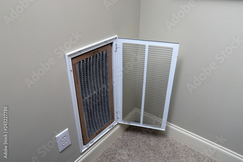 Photo  Replacing Dirty Air filter for home air conditioner