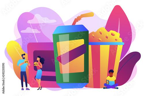 Valokuva  Business people eating hamburgers and drinking soft drinks near huge junk food