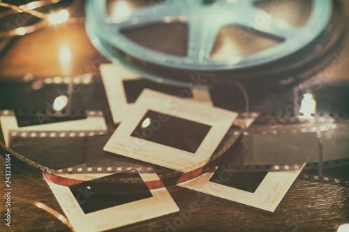 Photo slides, film negatives and 8mm or super 8 vintage film reel on a wood table with soft lights Wallpaper Mural