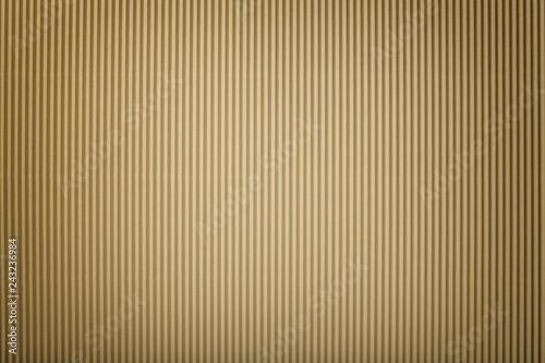 Foto  Texture of corrugated bronze paper with vignette, macro.